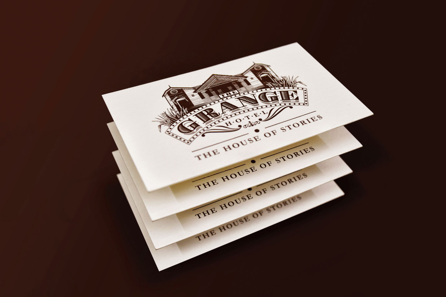 The business card of the grange hotel ooty with it's logo and logo type on it.